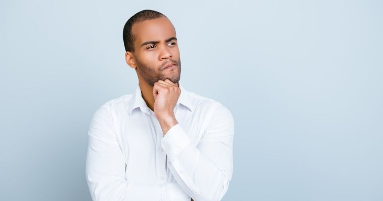 A man looking questioning about his bleeding gums and gum disease